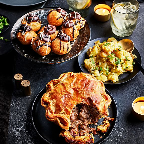 A selection of Gastropub dishes including steak pie and profiteroles
