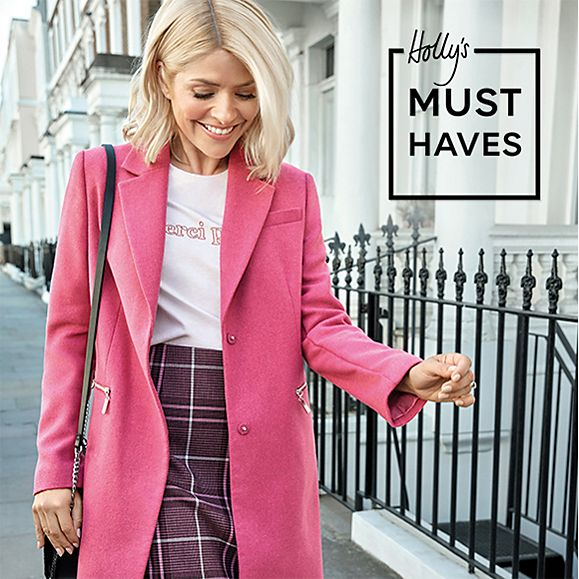 Holly Willoughby wearing a pink coat, white T-shirt and pink checked skirt