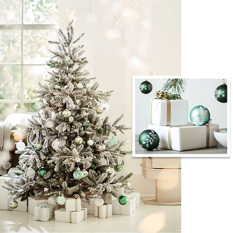 Christmas tree decorated in a white and green colour scheme and close-up of white