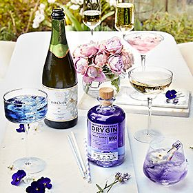 Lavender gin and champagne in a garden with glasses