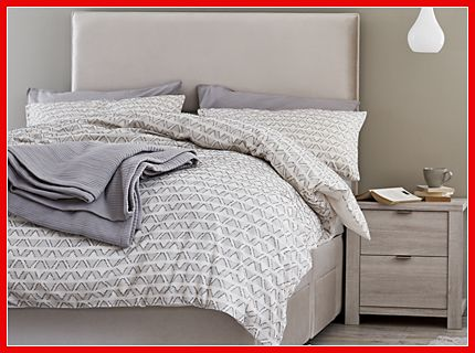 Grey patterned bedding on a double bed
