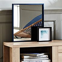 Mirror on a sideboard