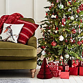 Sofa with cushions and Christmas tree