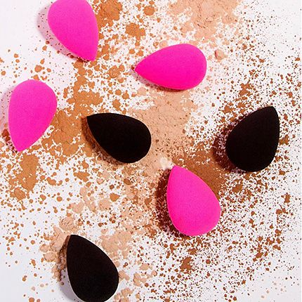 Beauty Blender make-up sponges surrounded by powder foundation
