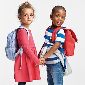 Children wearing M&S school backpacks