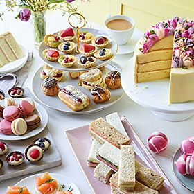 Selection of afternoon tea cakes, pastries and sandwiches