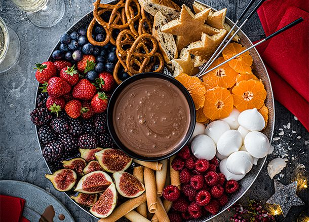 Collection chocolate cream served as a festive fondue with fruits and sweet treats