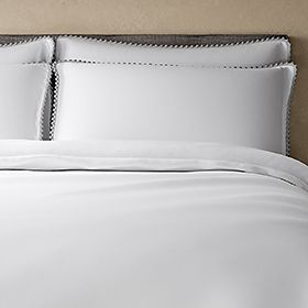 White luxury bedding with pom-pom edging