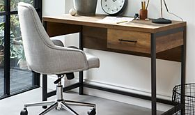 A wooden office table and white chair