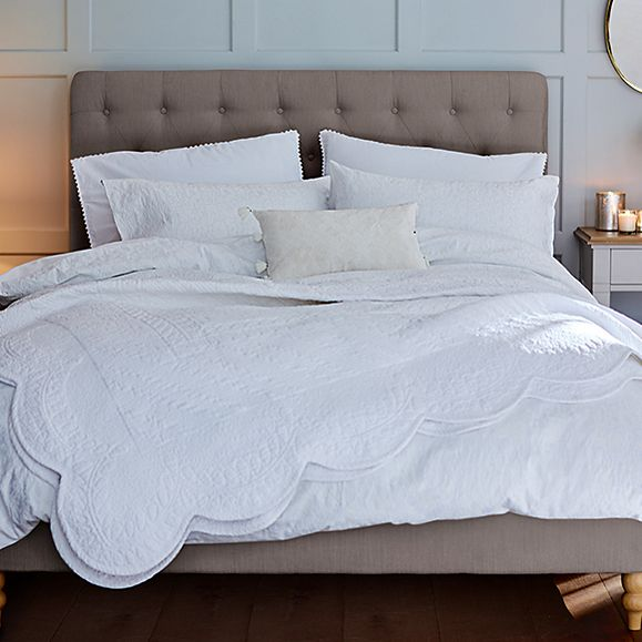 Bed with white luxury bedding