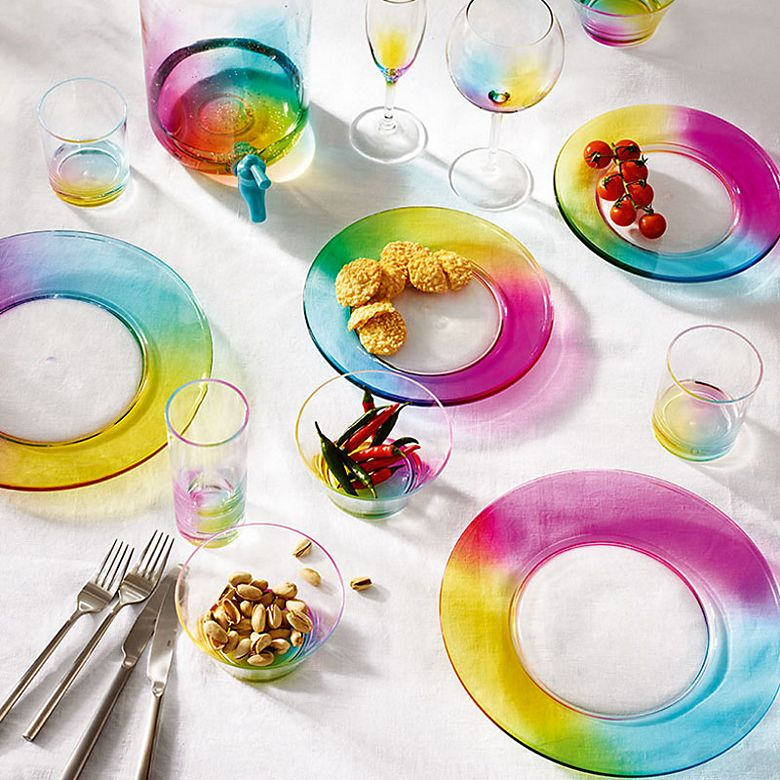Table set with rainbow picnicware, rainbow picnic glasses and rainbow picnic drinks dispenser