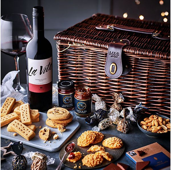Wicker hamper of foodie treats, including shortbread and wine
