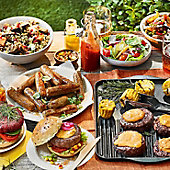 Barbecue feast of burgers, sausages, salads and sauces