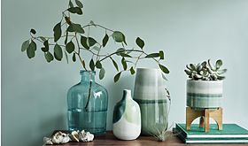 Green vases on a side table