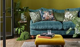 Blue sofa with cushions and footstool