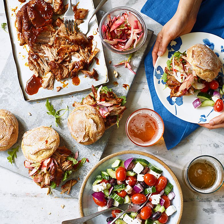 A slow-cooked barbecue pork shoulder with soft buns and crunchy slaw