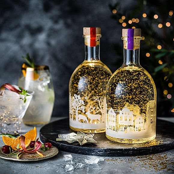 Clementine gin liqueur and rhubarb gin liqueur light-up snow globes