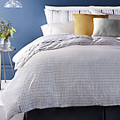 Patterned bedding set on bed