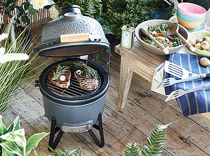 A Weber barbecue with steaks