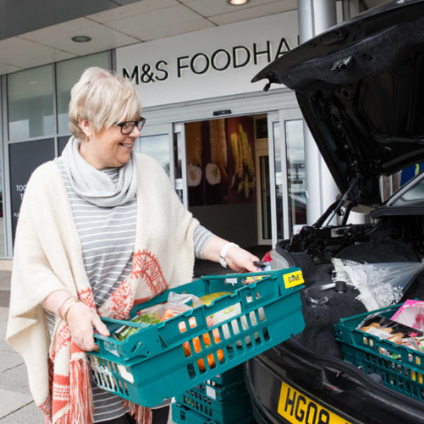 Packing food into car from M&S Foodhall