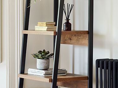 Artificial plant on shelving