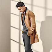 Man wearing camel wool coat and jumper