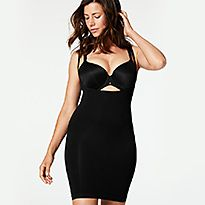 Woman wearing a black bra and black Secret Slimming™ light control shaping body