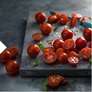 Cherry tomatoes on a slate board