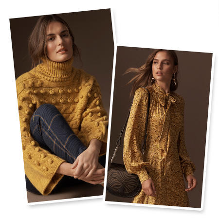 Model wears a mustard bobble-knit sweater over navy checked trousers & Model wears a mustard printed midi dress with a black cross-body bag