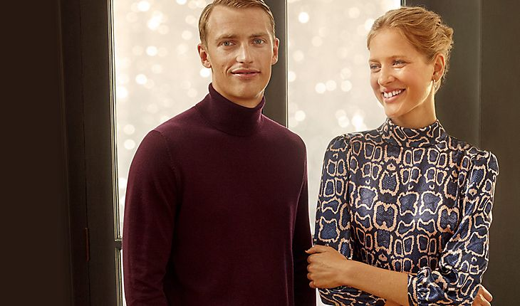 Man and woman wearing M&S partywear