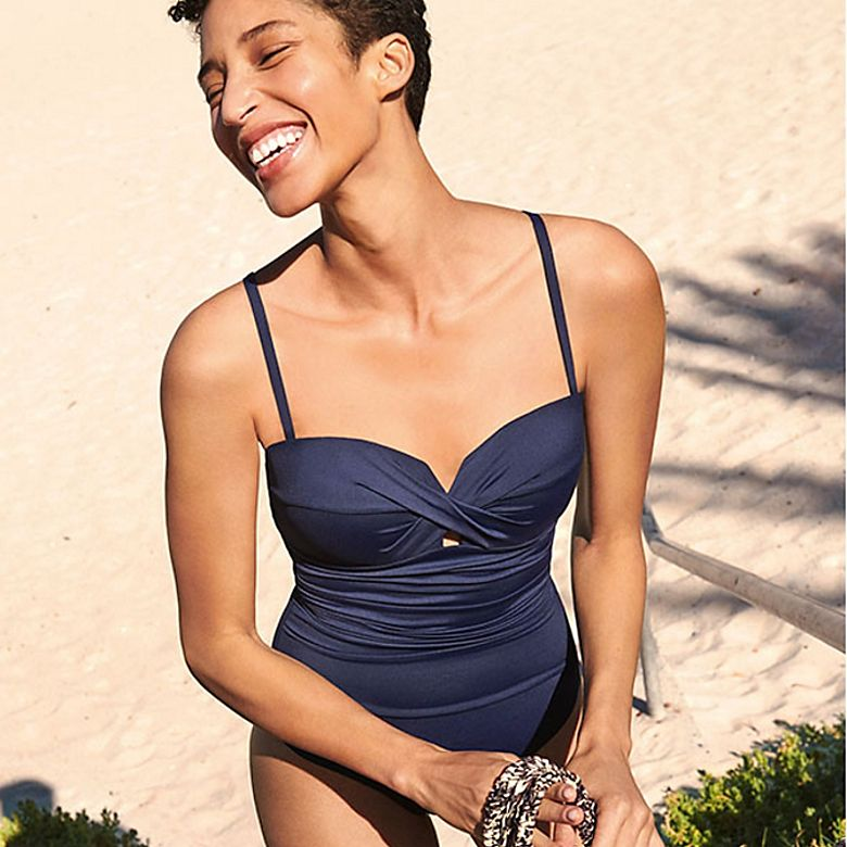 Woman wearing navy bandeau multi-way swimsuit