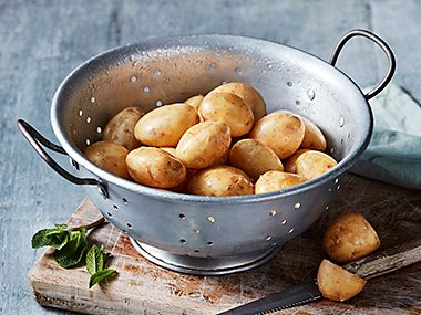 A colander filled with Jersey Royals