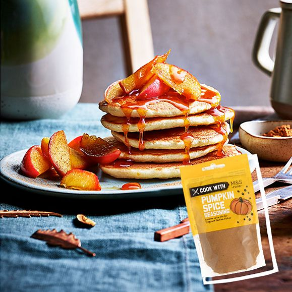 Pumpkin spice pancakes topped with caramelised apples and honey and pumpkin spice glaze