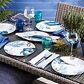 Garden table laid with picnicware and glassware