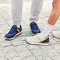 Two kids wearing M&S trainers