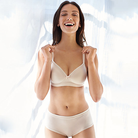 93204f50b Woman wearing Sumptuously Soft nude bra and knickers set