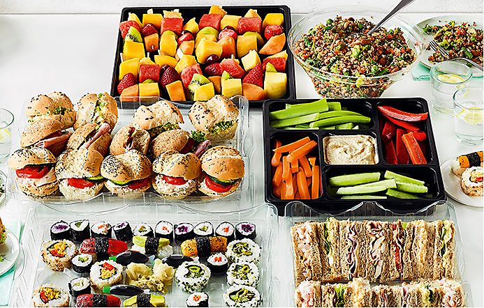 Spread of fresh sushi, sandwiches, salads and crudités
