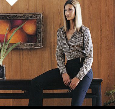 Woman wearing Autograph black trousers, a printed shirt and kitten heels, 2001