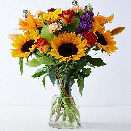 A bouquet of sunflowers in a glass vase