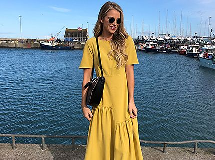 Vogue Williams wears a citrus yellow dress
