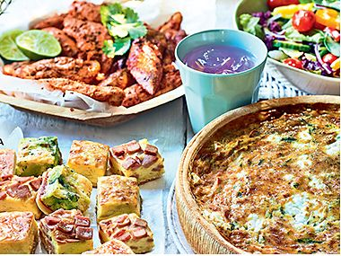 Picnic table with quiche, salad and drinks