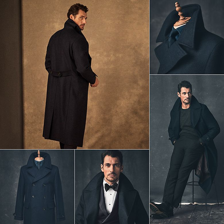 David Gandy wearing a longline navy overcoat