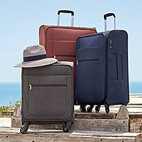 Wheelie luggage suitcases by the beach