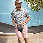 Man wearing printed shirt and pink shorts