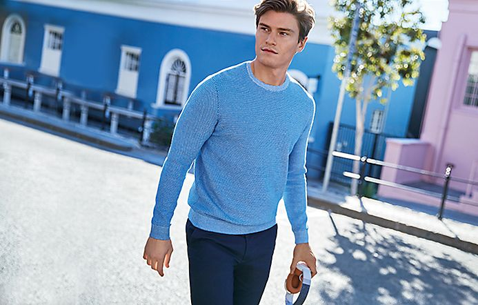 Man wearing blue crew-neck jumper