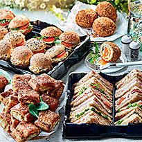 Platter of sandwiches, rolls, wraps and Scotch eggs