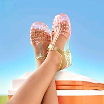 Girl with her feet up wearing coloured jelly sandals