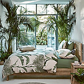 Palm print bedding on bed