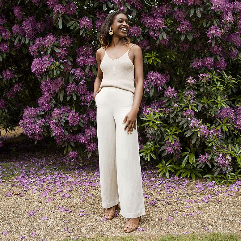 M&S Insider Dominique wearing head-to-toe beige against a floral backdrop