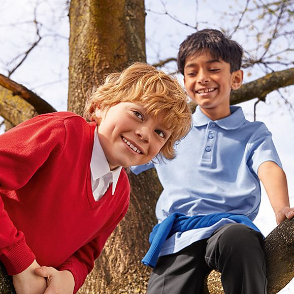 Two boys wearing M&S school uniform